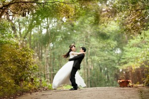young-couple-celebrating-wedding-on-dirt-road-in-forest